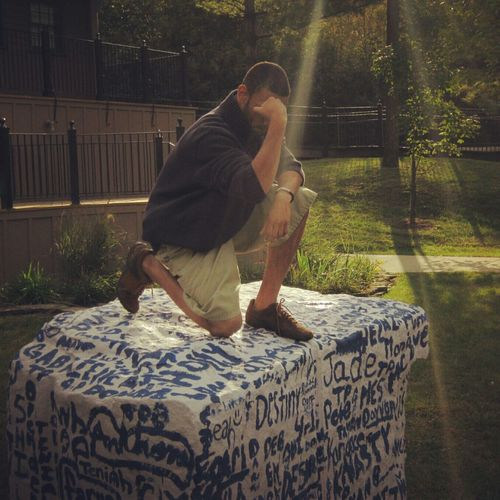 Me Tebowing on my schools rock with God's light shinning on me