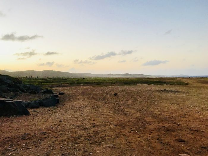 Antilles Arid Landscape Desert Travel Caribbean Landscape Nature Tranquil Scene Sky Beauty In Nature Tranquility Scenics Field No People Outdoors Day Grass