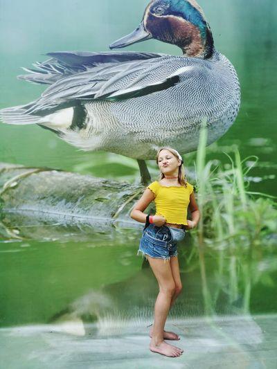 Full length of smiling girl standing in lake
