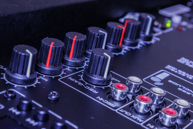 Close-up of sound mixer at recording studio