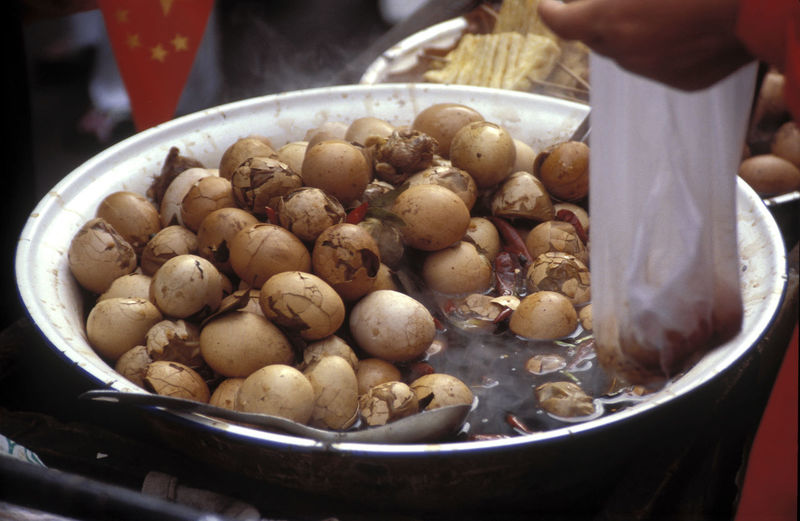 Bowl Chinese Food Close-up Day Food Food And Drink Freshness Healthy Eating Holding Human Body Part Human Hand Indoors  Lifestyles One Person People Ready-to-eat Real People Streetfood Tea Eggs