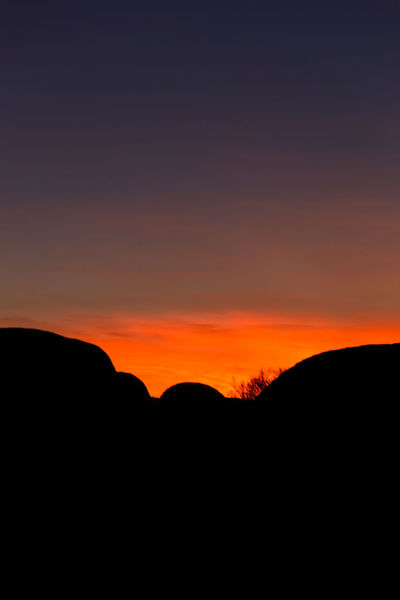 Sunrise at the Devils Marbles in the australian outback. Beauty In Nature Devils Marbles Landscape Morning Morning Light Nature No People Orange Color Outdoors Rock - Object Rock Formation Rock Object Scenics Silhouette Sky Sunrise Tranquil Scene Tranquility