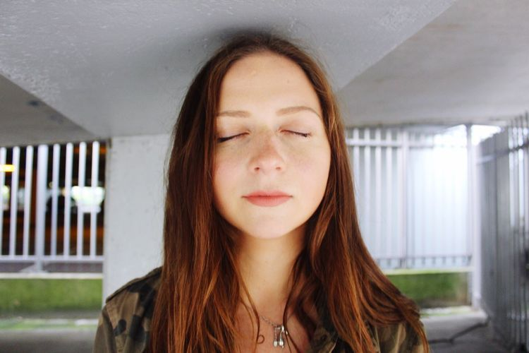 Close-up of young woman with eyes closed