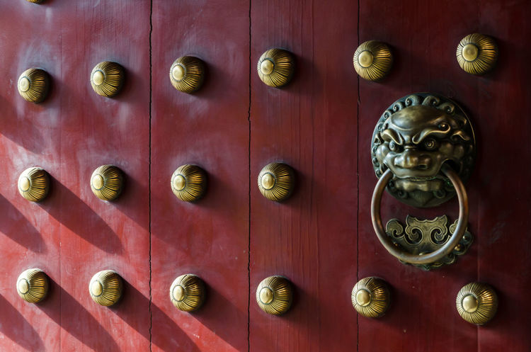 Traditional Chinese doors with brass lion head door knockers and ornamental studs. The number of studs represent status of the owner. Architecture Chinatown Security Singapore Chinese Culture Close-up Design Details Door Guardian Indoors  Knockers And Knobs Lion Hean Oriental Protection Religion Style Symbol Temple