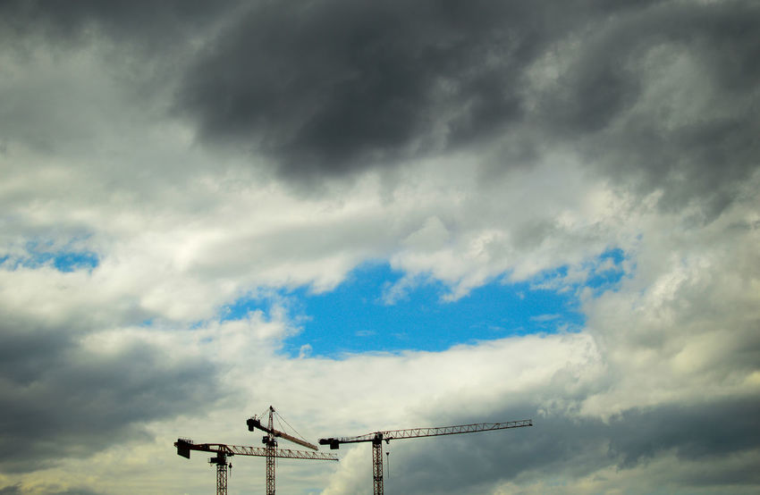 Berlin is under construction...all over the city 1/2 Berlin Photography City Life Cloudy Cranes Blue Sky Building Exterior Cloud - Sky Crane Cranes And Construction Day Low Angle View Nature No People Outdoors Sky