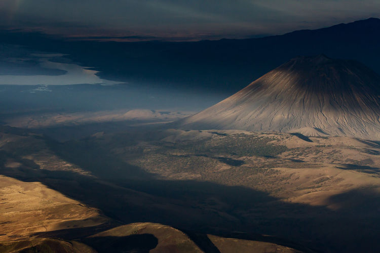 The Masai sacred volcano bathed in warm lights Active Volcano Aerial View Africa Beauty In Nature Cloud - Sky Day Landscape Mountain Nature No People Oldoyno Lengai Outdoors Scenics Sky Tanzania Travel Destinations