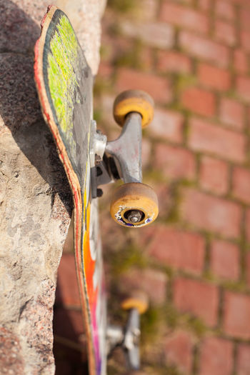 The colorful old skate is close-up and is located near a stone trail. Close-up Colorful Day Freedom Hobby No People Old Outdoors Shabby Skate Skateboard Skateboarding Skating Stone Street Trail Wheel