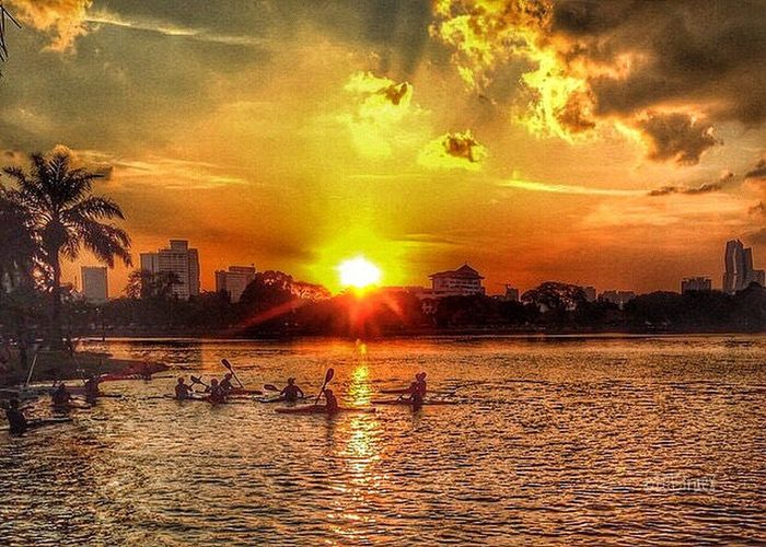 Sunset at Tasik Titiwangsa Sunset Sky Building Exterior Architecture Water Cloud - Sky Outdoors Built Structure City Scenics Large Group Of People Tree Cityscape Nature People Day