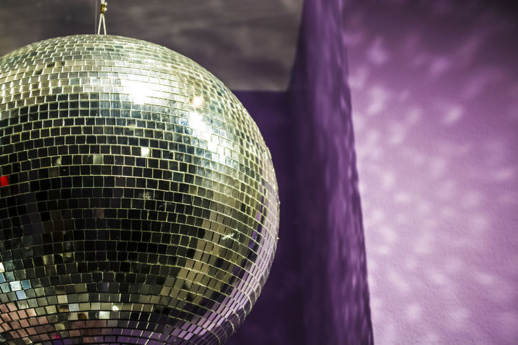 Disco Ball Reflection Nightlife Sphere Nightclub Night Close-up Shiny Celebration Arts Culture And Entertainment Event Illuminated Purple No People Silver Colored Focus On Foreground Hanging Party - Social Event Decoration Indoors  Disco Dancing Entertainment Club Dance Floor