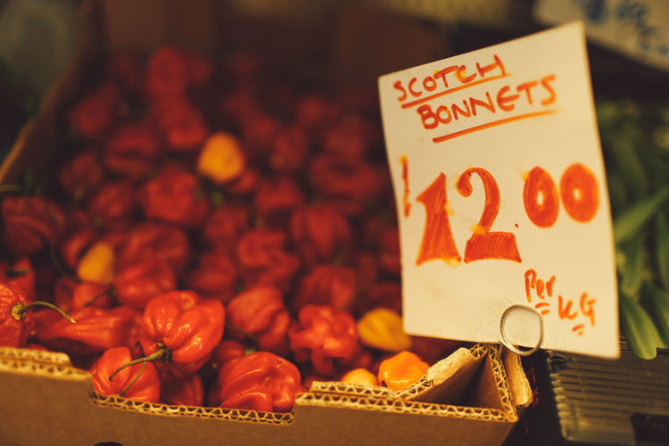 Price tag attached to scotch bonnet box at market stall