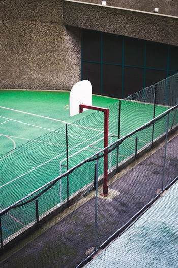 Barbican, City of London , Basketball, Football, Gre Barbed Wire Chainlink Fence Community Court Fence Football Green Lines Play Safety Sport