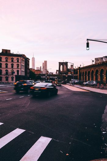 DUMBO Check This Out EyeEm Best Shots Taking Photos Traffic Transportation Travel Architecture Bridge Building Exterior Built Structure Car City City Life Cityscape Land Vehicle Motion Outdoors Road Street Streetphotography Sunset Transportation Travel Destinations Urban Urban Skyline