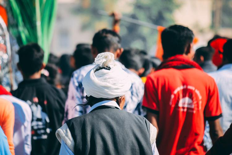 Rear view of people enjoying at street