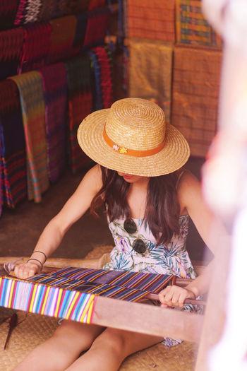 woman wearing hat wile working on floor