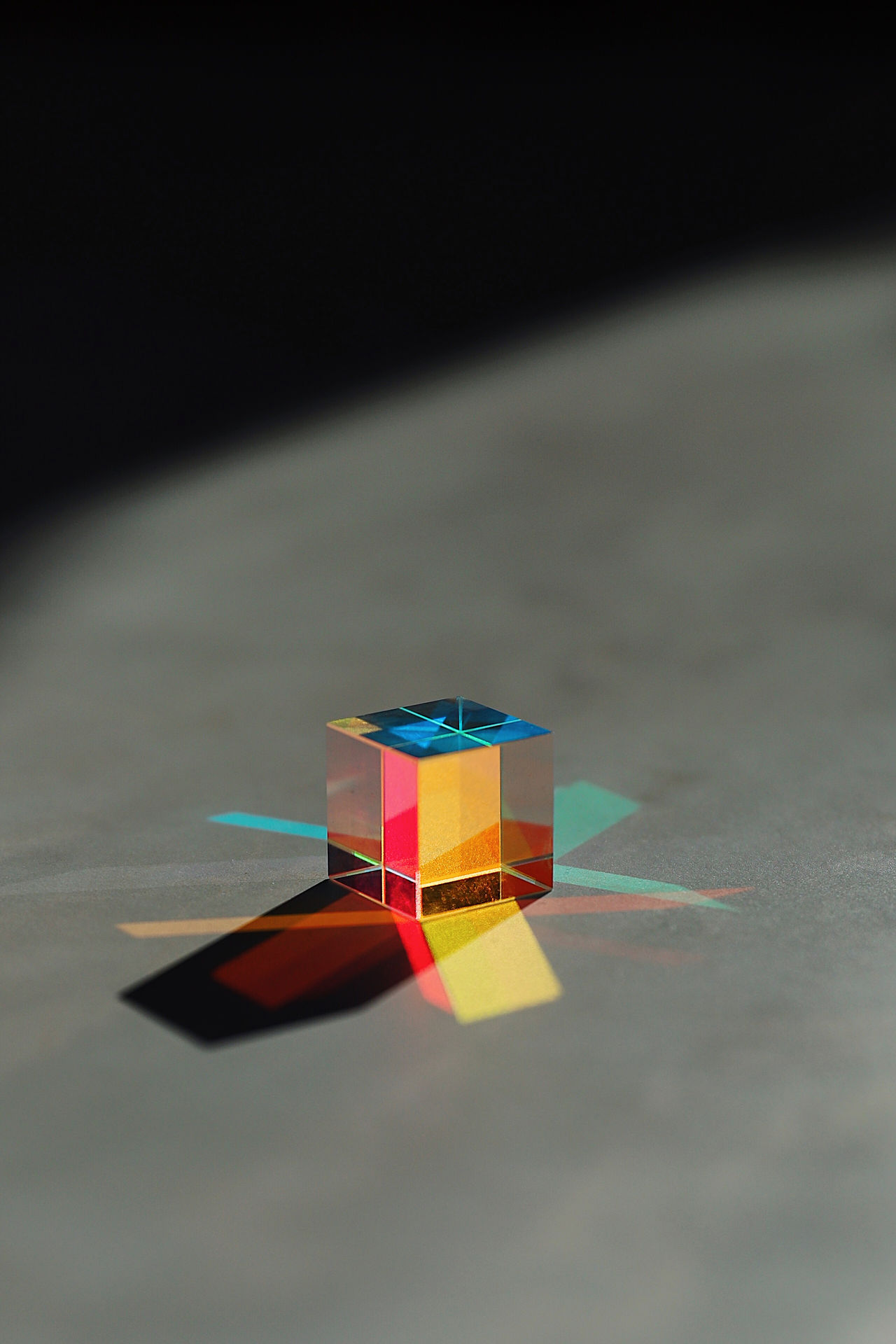 Cube shape on multi colored diagram on table