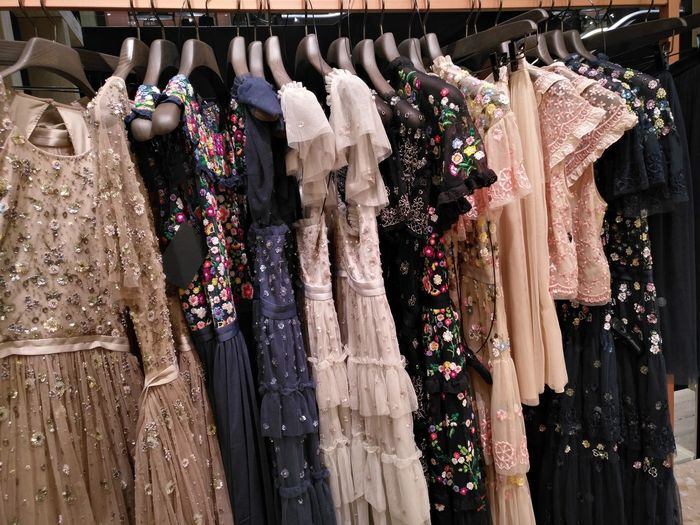 Dresses hanging in store for sale