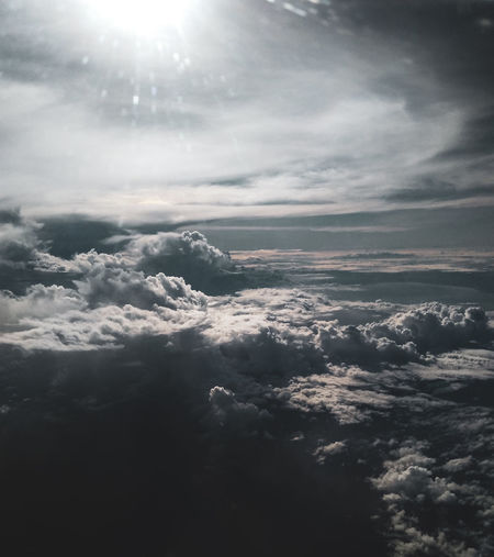 Aerial view of clouds over landscape against sky