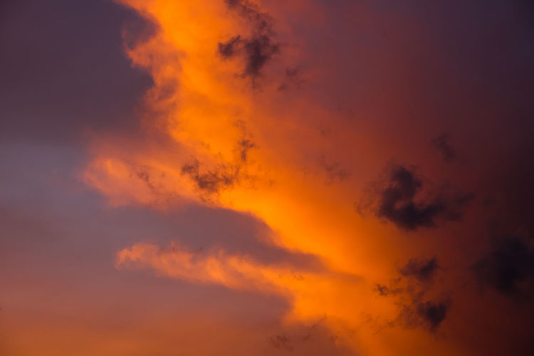 Abstract Beauty In Nature Cloud - Sky Cloudscape Dramatic Sky Dusk Environment Idyllic Low Angle View Majestic Meteorology Multi Colored Nature No People Orange Color Outdoors Romantic Sky Scenics - Nature Sky Sunset Tranquil Scene Tranquility Vibrant Color