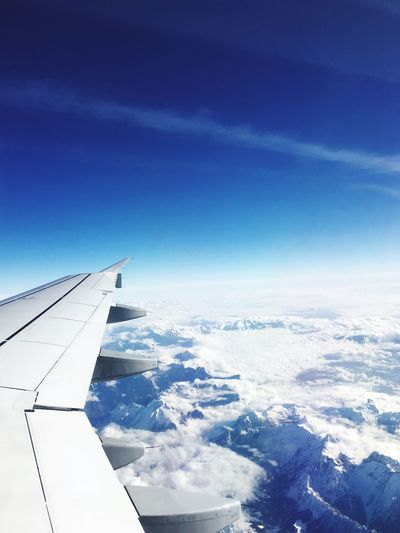 It's the alps From An Airplane Window Airplane Nature Aerial View Blue Beauty In Nature Scenics Transportation Airplane Wing Cold Temperature Travel Outdoors Sky