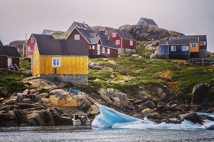 Typical houses painted different colours in Kulusuk, Greenland EEprojects Nature House LiveTravelChannel Canon_photos Snapzone Travelling Iceberg Ice Cold Mountain Frozen Island Greenland Arctic Colorful Paint Grass Building Destination Rock Glacier Avalanche  @natgeo @natgeotravelTravelawesome Awesomeearth fantastic_earth@wildlifeplanetbeautifuldestinations@discoverearth