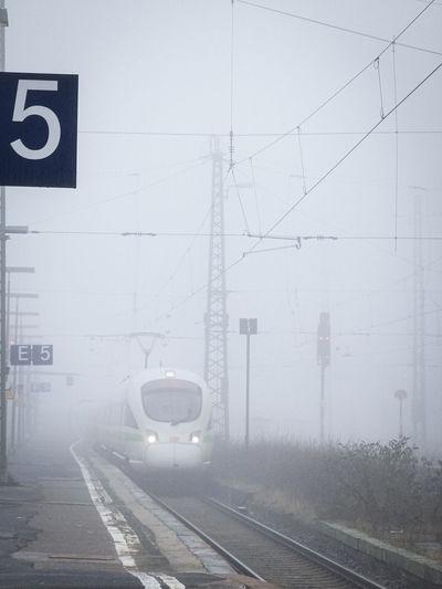 Train on railroad tracks in foggy weather
