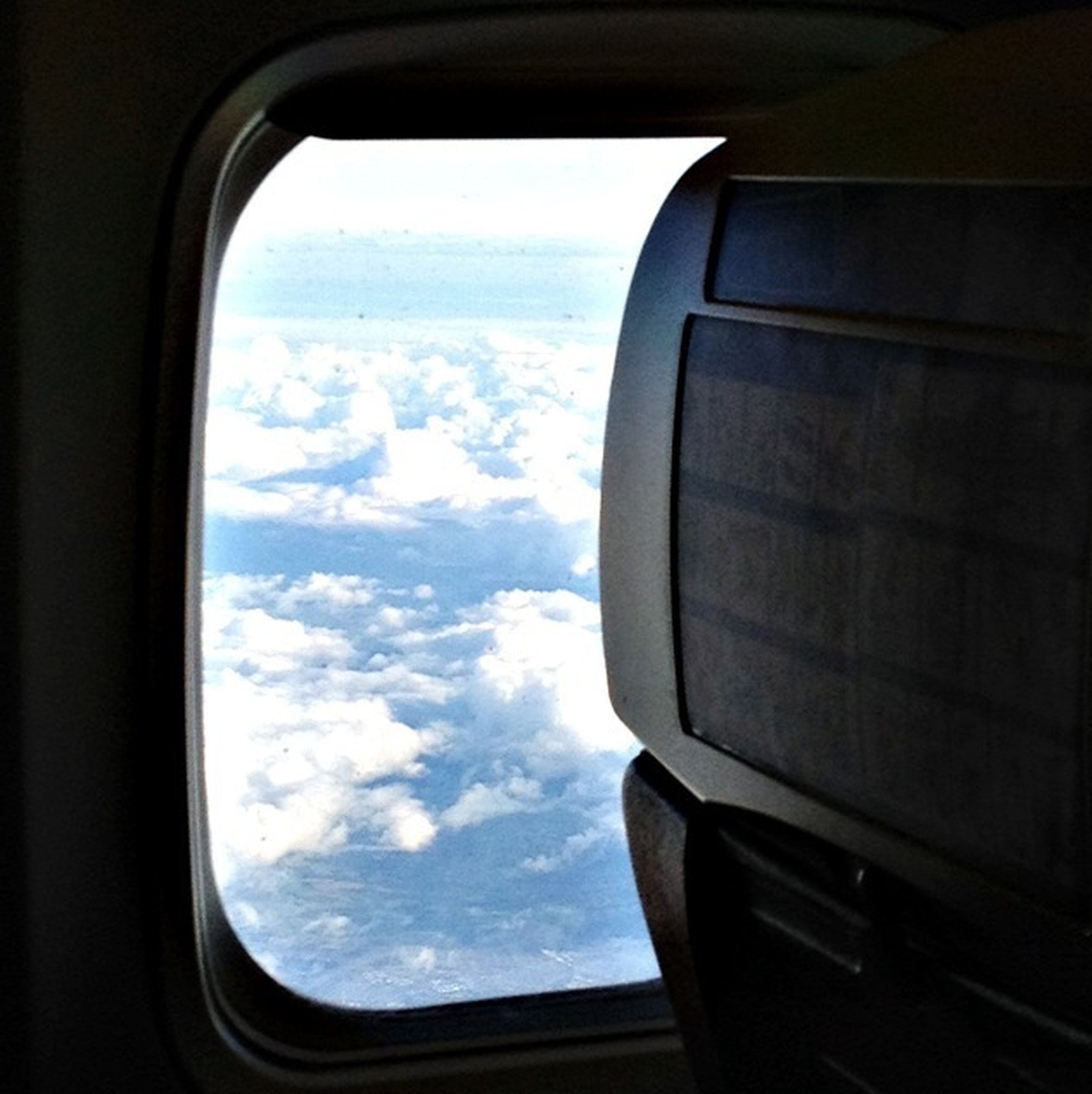 transportation, vehicle interior, mode of transport, window, airplane, sky, glass - material, transparent, car, cloud - sky, air vehicle, part of, travel, land vehicle, cropped, cloud, journey, public transportation, looking through window, indoors