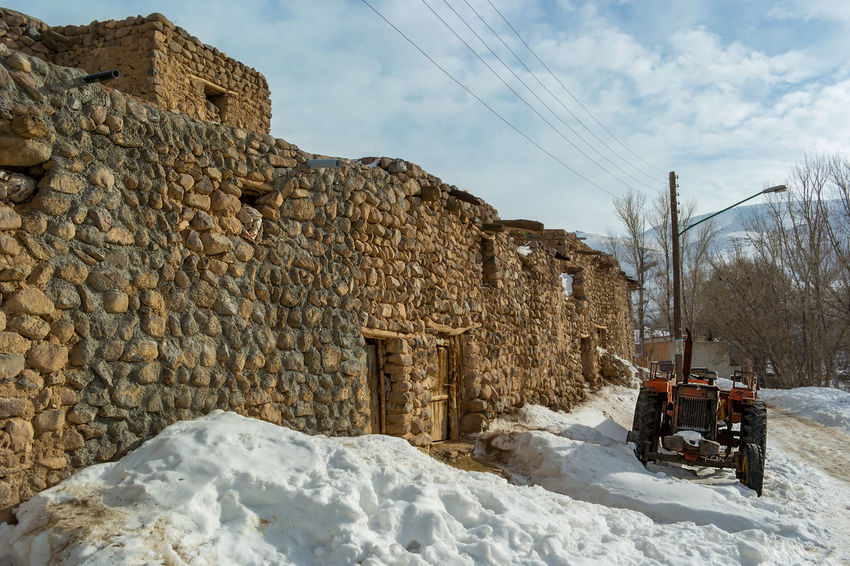 The small village of Kandovan near to Tabriz, Northern Iran. Also known as Irans Cappadocia due to its unique rock formations that locals and caved out and used as their homes for hundreds of years. Cappadocia Kandovan Ancient Civilization Architecture Building Exterior Built Structure Cable Cloud - Sky Cold Temperature Day History Land Vehicle Mode Of Transportation Nature No People Outdoors Sky Snow Stone Wall Transportation Travel Winter
