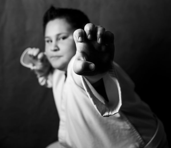Portrait Of Boy Doing Martial Arts
