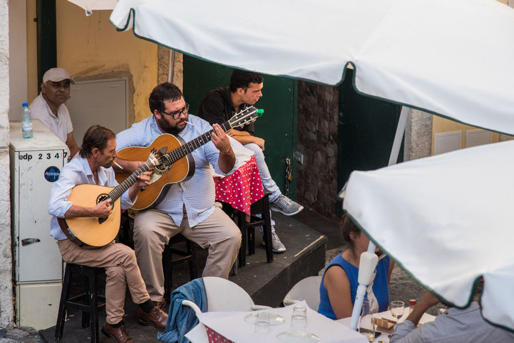 Lifestyle Music Portugal Arts Culture And Entertainment Casual Clothing Fado Guitar Leisure Activity Lifestyles Lisboa Lisbon Music Music Brings Us Together Musical Instrument Musical Instrument String Musician Outdoors Performance Playing Real People Sitting Street Streetphotography String Instrument Togetherness