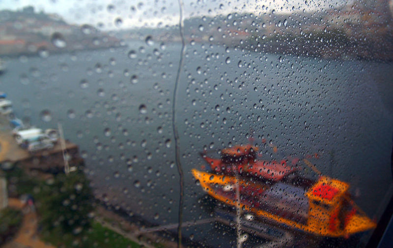 Rainy day. Drop Wet Rain Window Glass - Material Transparent Water Rainy Season RainDrop Mode Of Transportation No People Close-up Nature Monsoon Motor Vehicle Architecture Indoors  Car Glass Boat Rainy Days Nature Reflection Metro River