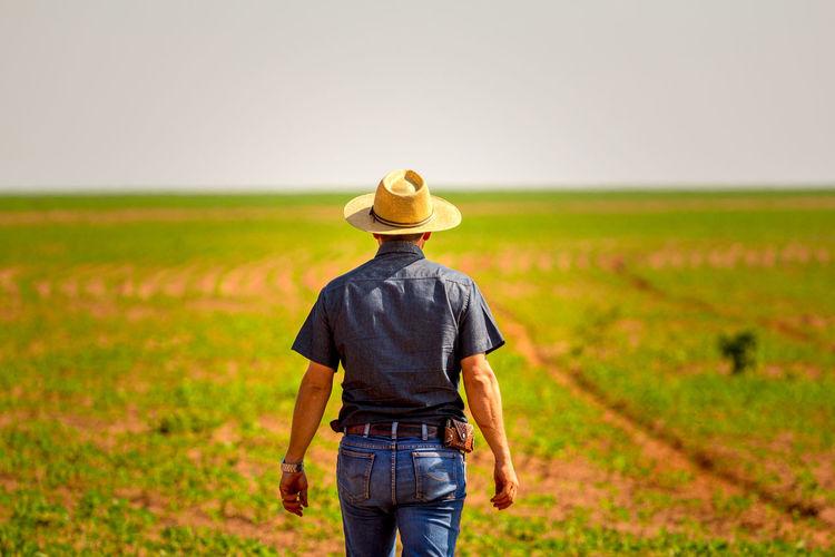 Rear view of man standing in field