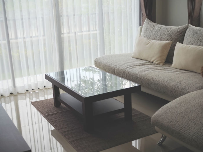 Furniture Indoors  Home Interior Window Curtain Pillow Absence Sofa No People Comfortable Living Room Chair Seat Domestic Room Home Showcase Interior Cozy Cushion Table Stuffed Empty Coffee Table Modern Luxury Armchair
