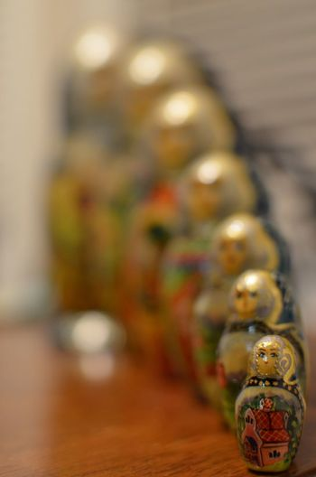 Sisters Indoors  Close-up No People Multi Colored Table Christmas Nesting Dolls Selective Focus Antique Collection Big To Small