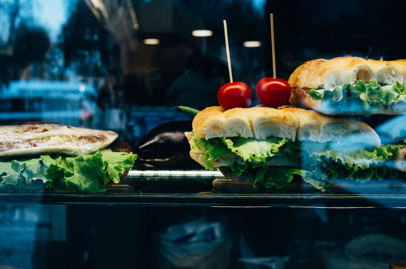 Close-up of sandwiches served on glass table
