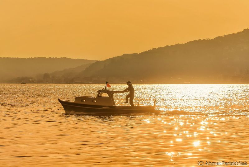 Richest Man In The World Sunset Water Silhouette Mountain Scenics Transportation Waterfront Tranquil Scene Boat Sea Tranquility Mountain Range Calm Idyllic Orange Color Rippled Ocean Beauty In Nature Outline
