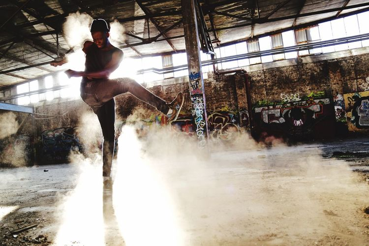 Dancing In The Dust Old Factory Dust Black Man Dancing African Dancing Men Against Racism Multicultural Dancing Movement Photography Movement Real People Water Motion Lifestyles Nature Day Splashing Leisure Activity Enjoyment Built Structure People Architecture Sport Sunlight Spraying Men
