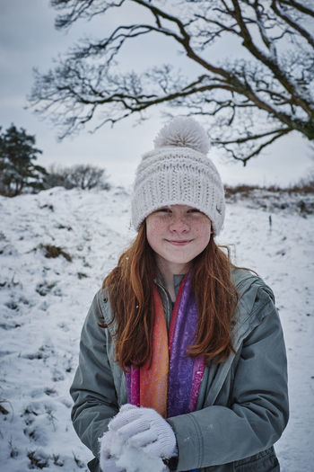Portrait of smiling girl in snow field