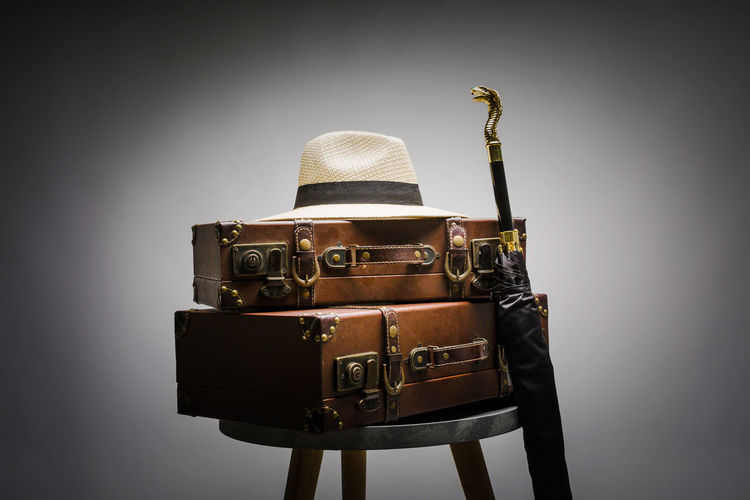 Old Suitcase Arts Culture And Entertainment Indoors  Retro Styled Still Life Studio Shot Suitcase Suitcasetravels Umbrella
