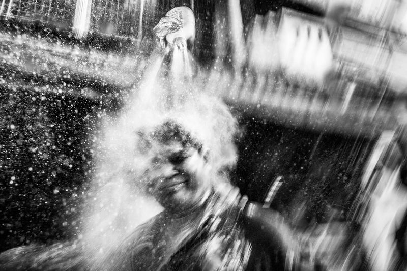 Freak Songkran / Songkran is an annual festival in Thailand celebrating the traditional Thai New Year. Water is splashed and poured onto people as a symbol of washing away all of their sins and bad luck. Sometimes, it gets a little freaky. Bangkok Thailand. Water Check This Out Blackandwhite Dark EyeEm Best Shots Showcase July Black And White Black & White Streetphoto_bw Streetphotography Streetphoto Photooftheday Streetphotographer Street Photography Thailand Bangkok EyeEm Best Shots - Black + White Funny
