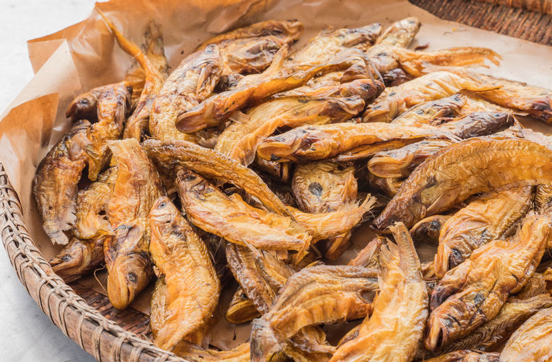 Close-up of dry fish in basket for sale