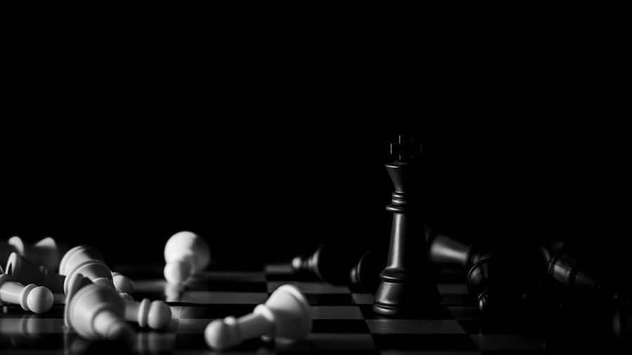 Leisure Games Chess Game Board Game Chess Piece Relaxation Strategy Leisure Activity Studio Shot Indoors  Black Background Chess Board Copy Space Competition Close-up Arts Culture And Entertainment No People Large Group Of Objects Still Life Pawn - Chess Piece King - Chess Piece