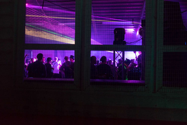 Music Through Window Adult Architecture Arts Culture And Entertainment Audience Clubbing Copy Space Crowd Enjoyment Frame Illuminated Indoors  Large Group Of People Left Out Leisure Activity Lifestyles Men Night People Real People Silhouette Sitting Togetherness Watching Window Women Sommergefühle