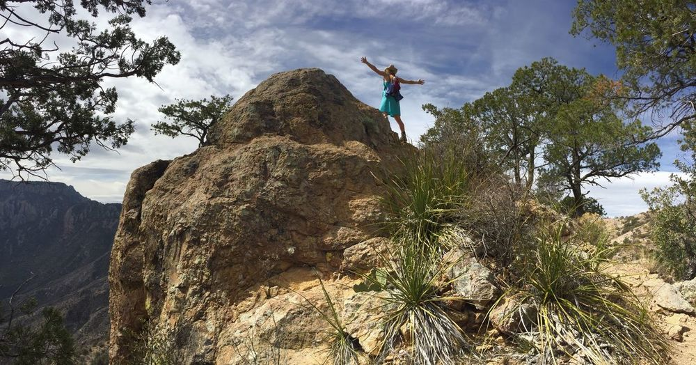 Low angle view of woman on rock formation at big bend national park