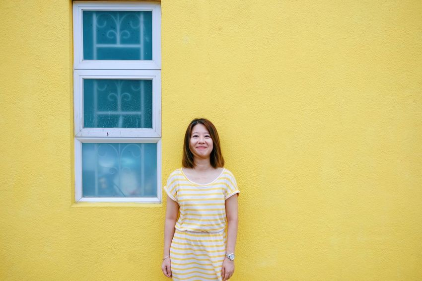 Same Color Ihaveathingforwalls Yellow One Person Women Architecture Wall - Building Feature Built Structure Smiling Looking At Camera Hairstyle Lifestyles Happiness Standing Moments Of Happiness