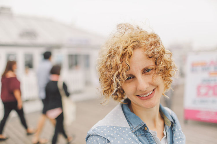 Beach Blonde Brighton Brighton Pier Casual Clothing Close-up Curly Hair Day Focus On Foreground Fog Foggy Girl Headshot Leisure Activity Lifestyles Outdoors Portrait Sea Seaside Selective Focus Shore Summer Toothy Smile Connected By Travel