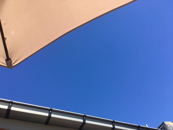 Low angle view of clear blue sky on sunny day