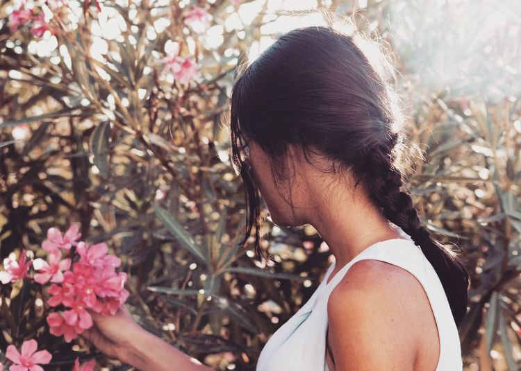 Woman Plucking Flowers
