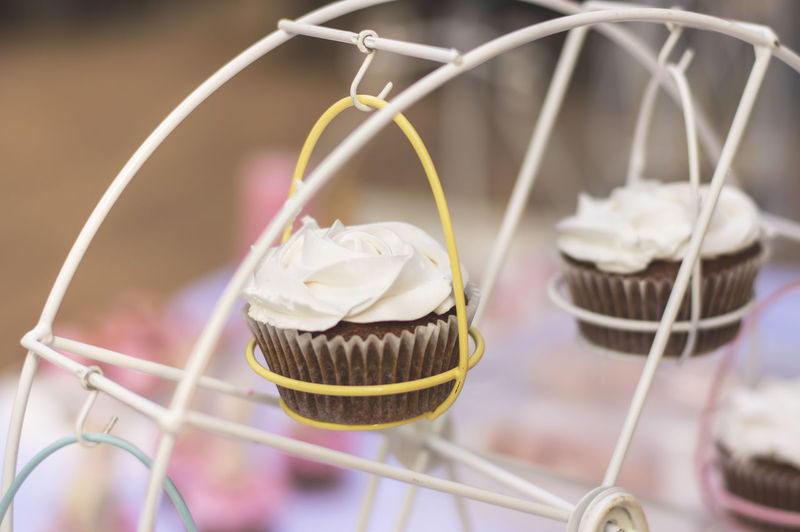 Close-up of cupcakes in stand on table