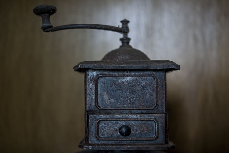 Close-up of old electric lamp on table