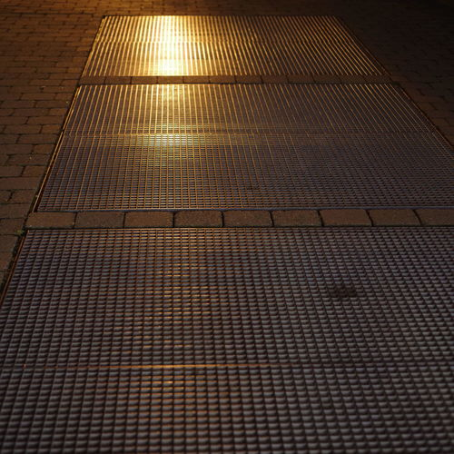 Pattern High Angle View No People Sunlight Full Frame Backgrounds Day Flooring Architecture Metal Repetition Outdoors Grid Nature Design Grate Roof Technology Metal Grate Roof Tile